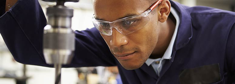 Man using a drilling machine